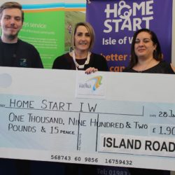 Picture shows Alison Griffiths (middle) receiving a cheque from Island Roads staff fundraising committee members Joe Robinson (left) and Maria Escandell (right)