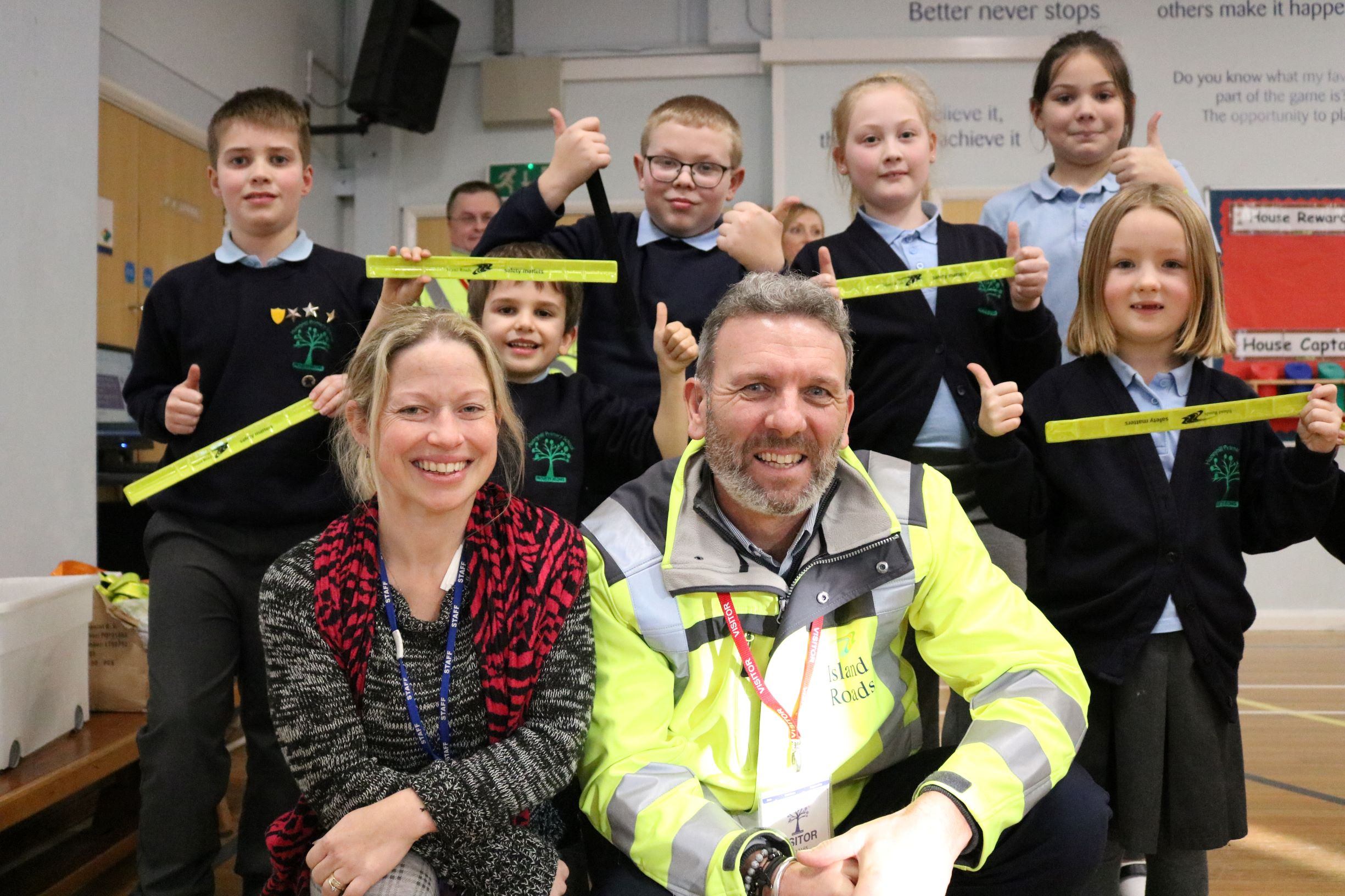 Photo shows pupils from Hunnyhill primary school with their teacher and a member of Island Roads staff at a safety talk