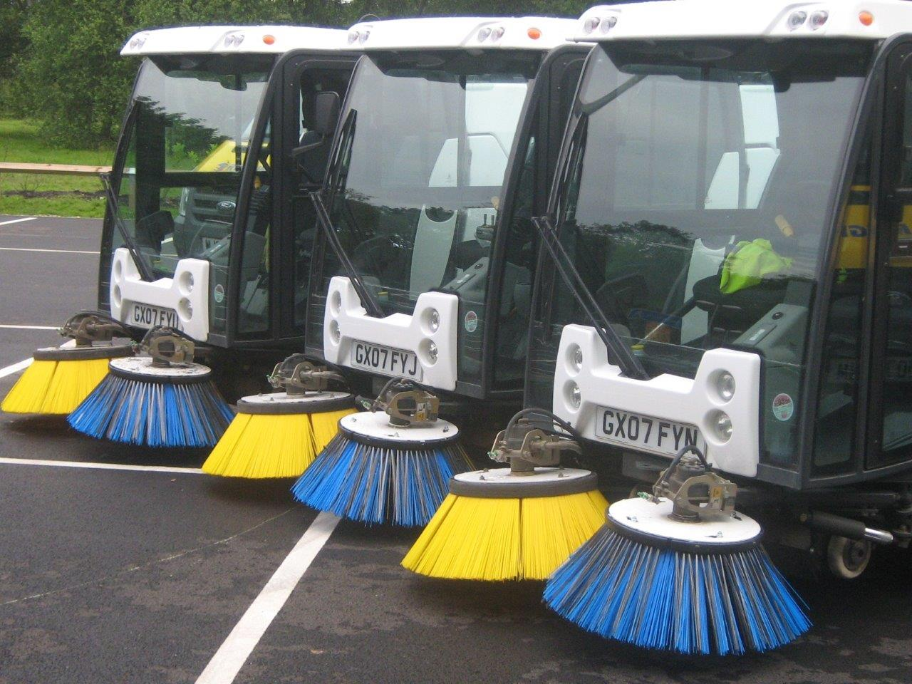 Picture showing three street cleansing vehicles
