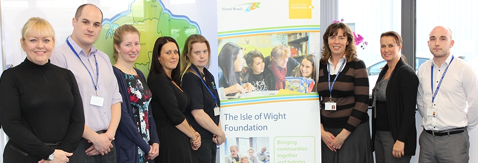 Photo showing Island Roads staff members with the Isle of Wight Foundation banner