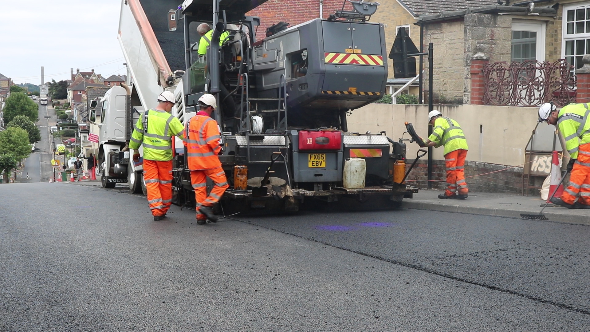photo showing Island Roads crew members resurfacing Victoria Road in Cowes