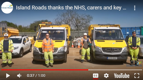 Still from a video taken to thank the NHS showing Island Roads workers in PPE in front of their vehicles