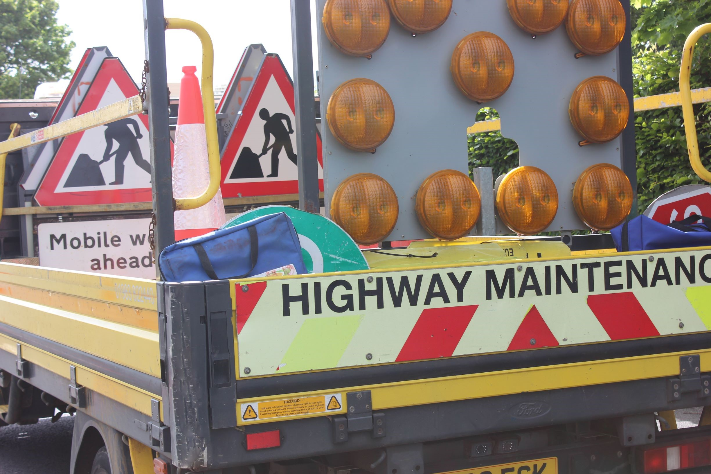 Photo showing highway maintenance vehicle loaded up with signage for site works