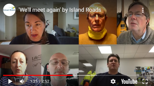 Still from a video showing Island Roads staff singing on screen