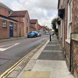 Photo showing road surface in Crocker Street ahead of roadworks