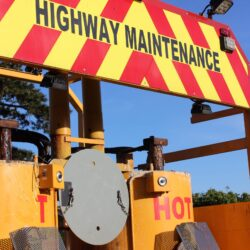 Photo showing reverse of maintenance lorry with highway maintenance sign and equipment