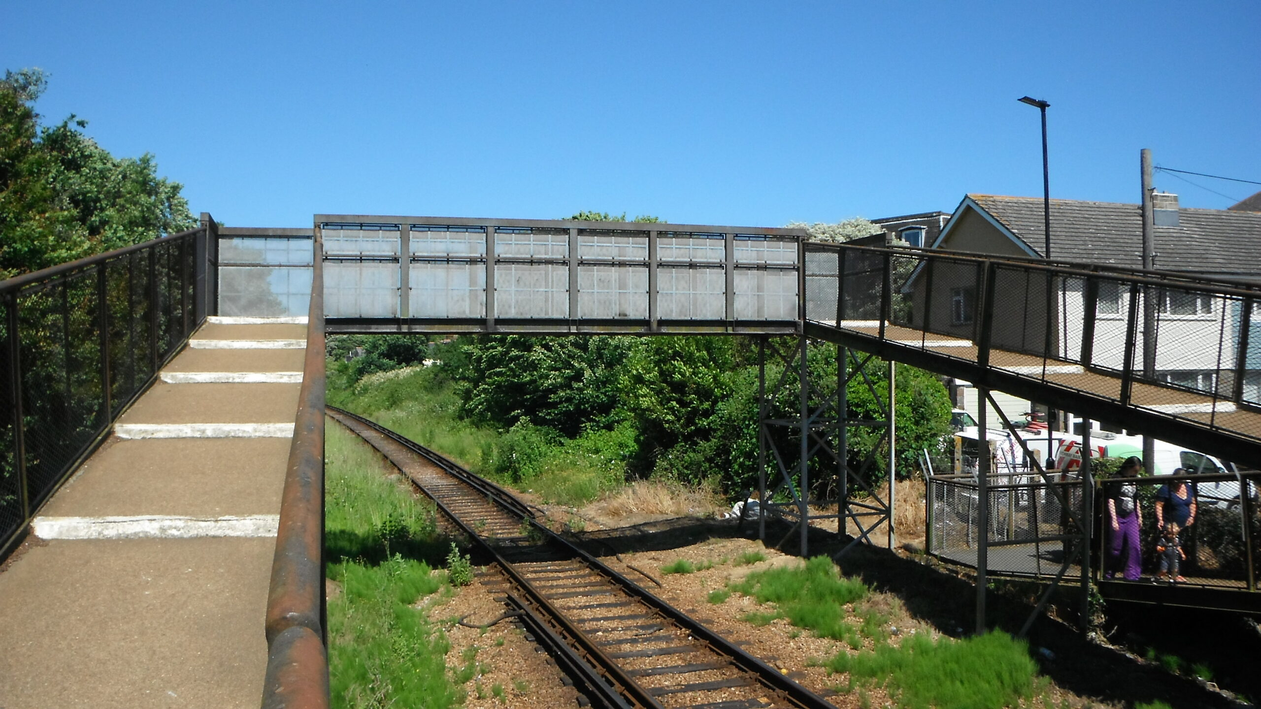 Photo showing a footbridge going across the railway track at Arelsford Road.