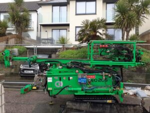 Photo shows specialist engineering rig on the road outside properties in Ventnor