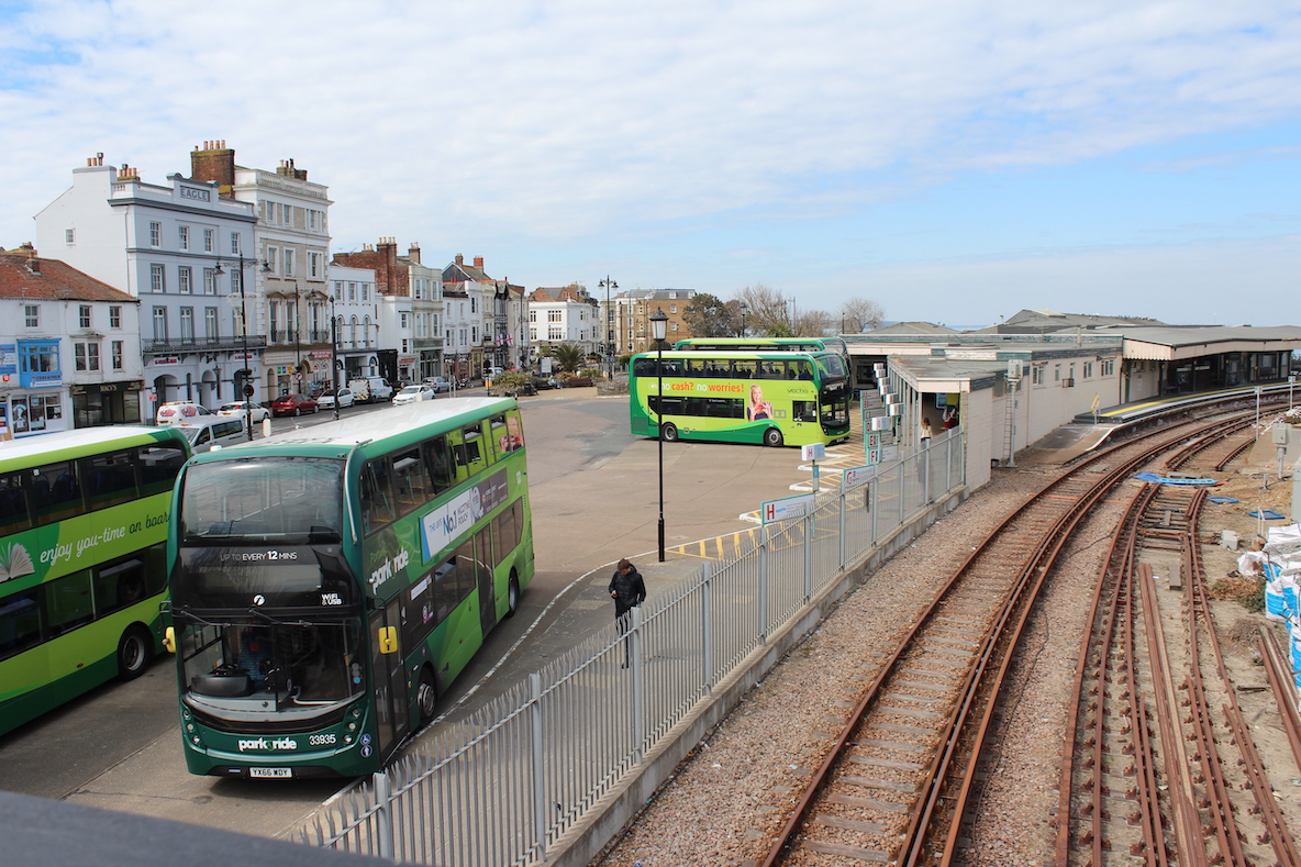 Photo showing the railway line at Ryde, Ryde bus station and the buildings along the Esplanade in the background