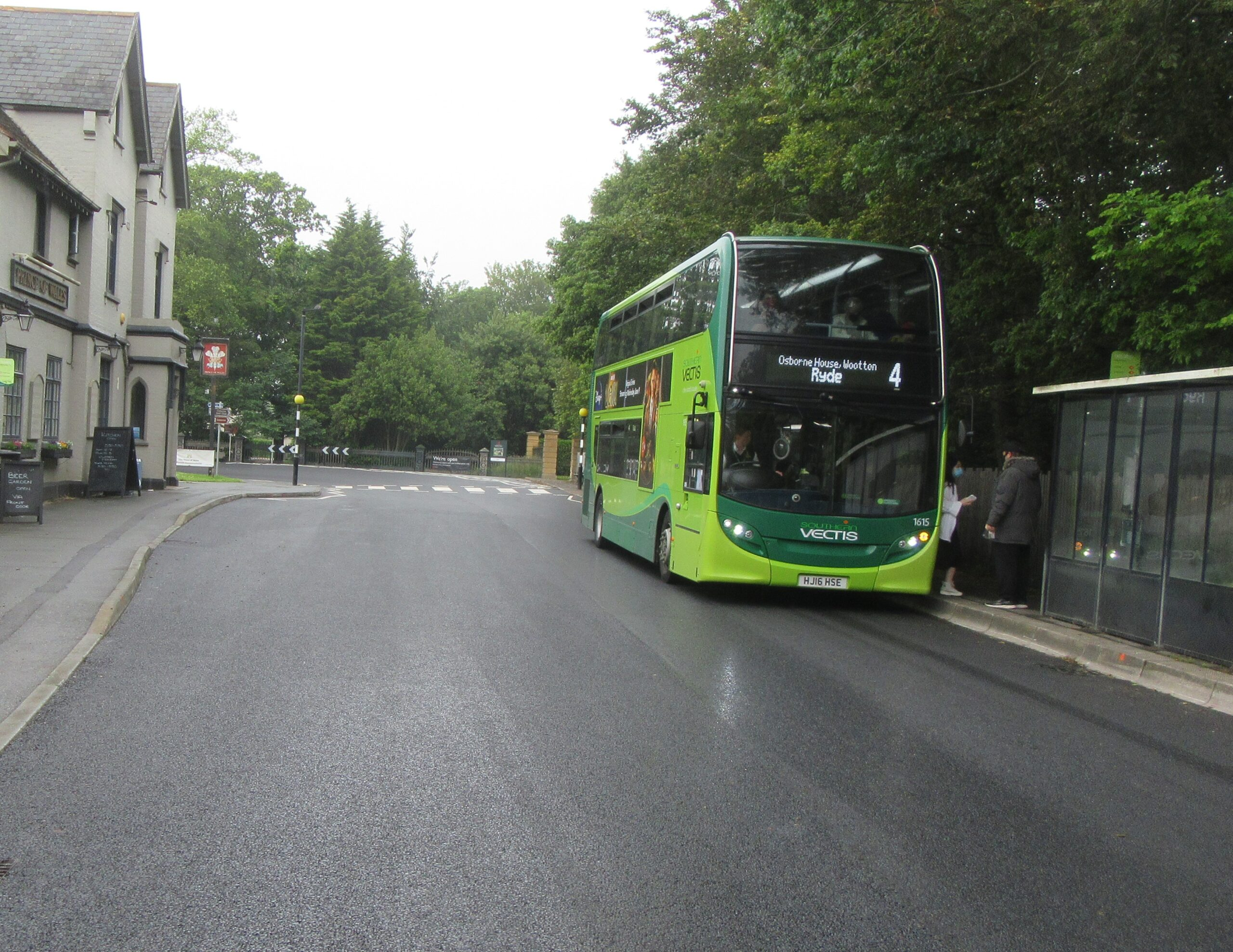 Photo showing the resurfaced road in York Avenue outside the garage on the approach to Osborne House in East Cowes. Bus on the right hand side at the bus stop.