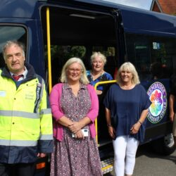 Picture shows volunteers and Island Rads' Mark Eliiott standing by the new bus